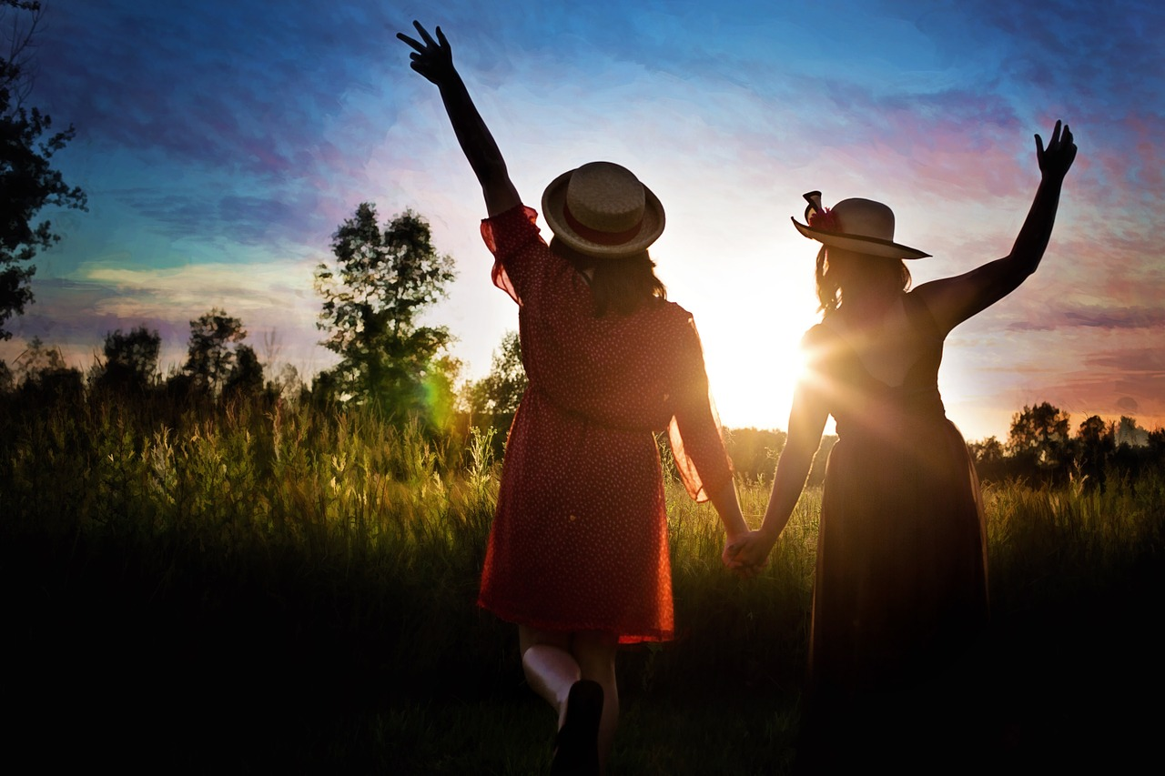 Friends, friendship, field, sun, sunshine, trees, grass, holding hands, hats, dresses, love, happy, relationships