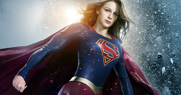 Supergirl standing with her first clenched, ready to take action., pop culture, movies/tv