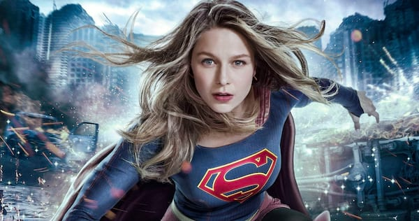 Supergirl crouched down in the middle of chaos., pop culture, movies/tv