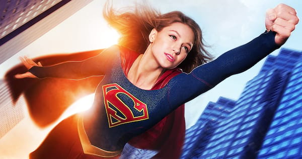 Supergirl flying through the air with buildings in the background., movies/tv, pop culture