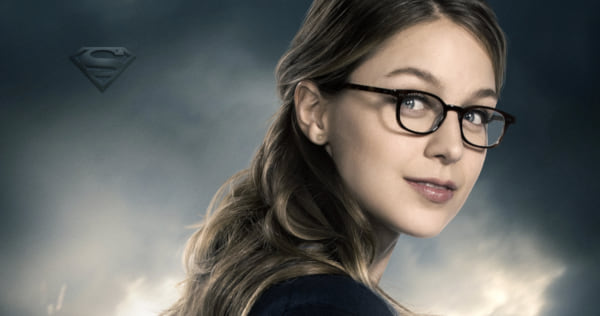 Supergirl wearing her disguise and looking over her shoulder., pop culture, movies/tv