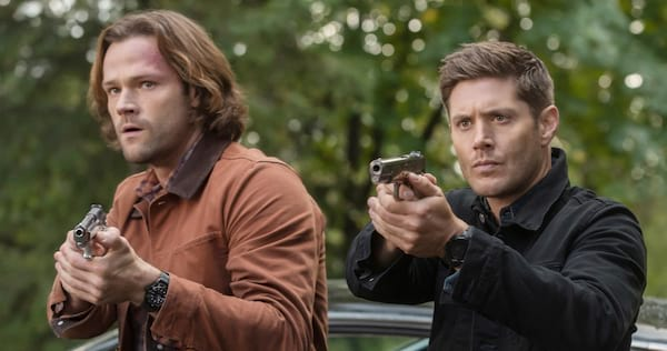 Sam and Dean pointing guns at someone., pop culture, movies/tv