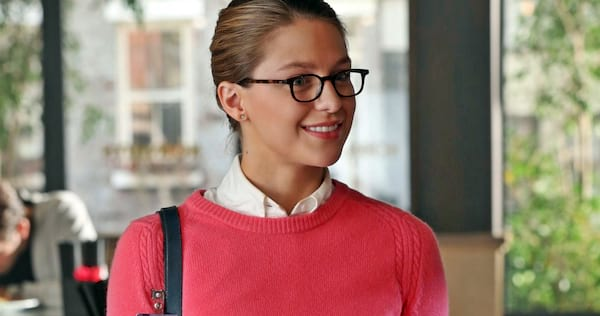 Kara wearing a pink sweater and smiling., movies/tv, pop culture