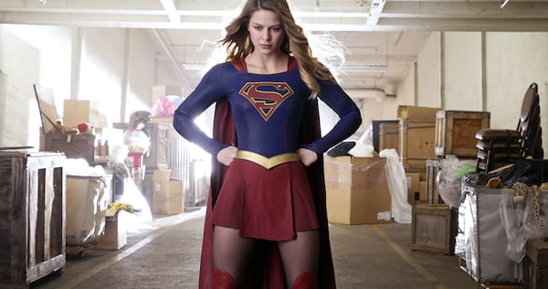 Supergirl standing in a warehouse with her hands on her hips., pop culture, movies/tv