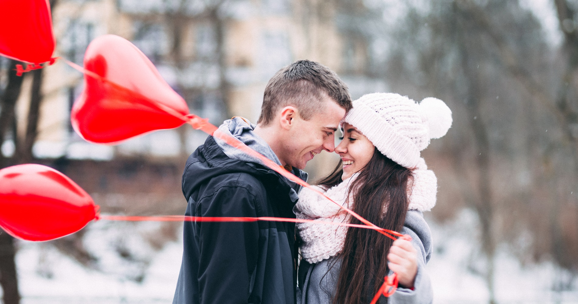 Couple standing together with red balloons., science & tech, relationships