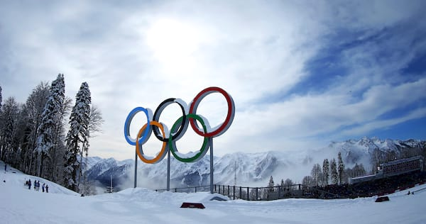 The Olympic rings with snowy mountains in the background., science & tech