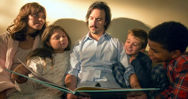 Jack from This Is Us reading a book to his family., wdc-slideshow, pop culture, movies/tv