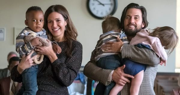 Jack and Rebecca from This Is Us holding their children., wdc-slideshow, pop culture, movies/tv