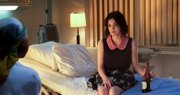 Stella from Life Sentence sitting on a hospital bed with a bottle of wine in her hand., wdc-slideshow, pop culture, movies/tv