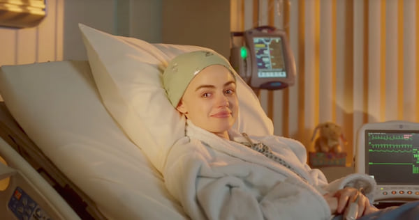 Stella from Life Sentence tearing up as she lies in a hospital bed., pop culture, movies/tv, wdc-slideshow