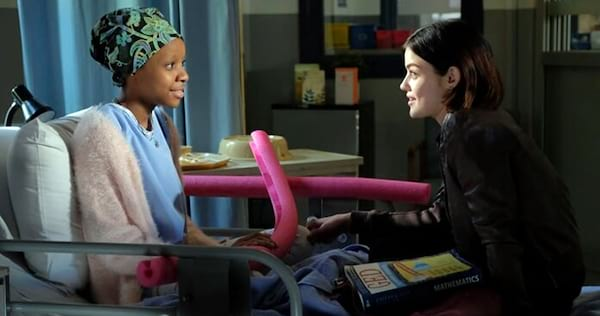 Stella and Sadie from Life Sentence sitting on a hospital bed and talking., pop culture, movies/tv, wdc-slideshow