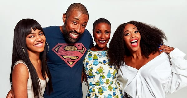 The cast of Black Lightning standing together and smiling., wdc-slideshow, movies/tv, pop culture