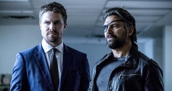 Oliver Queen and Deathstroke from Arrow stand next to each other., wdc-slideshow, pop culture, movies/tv