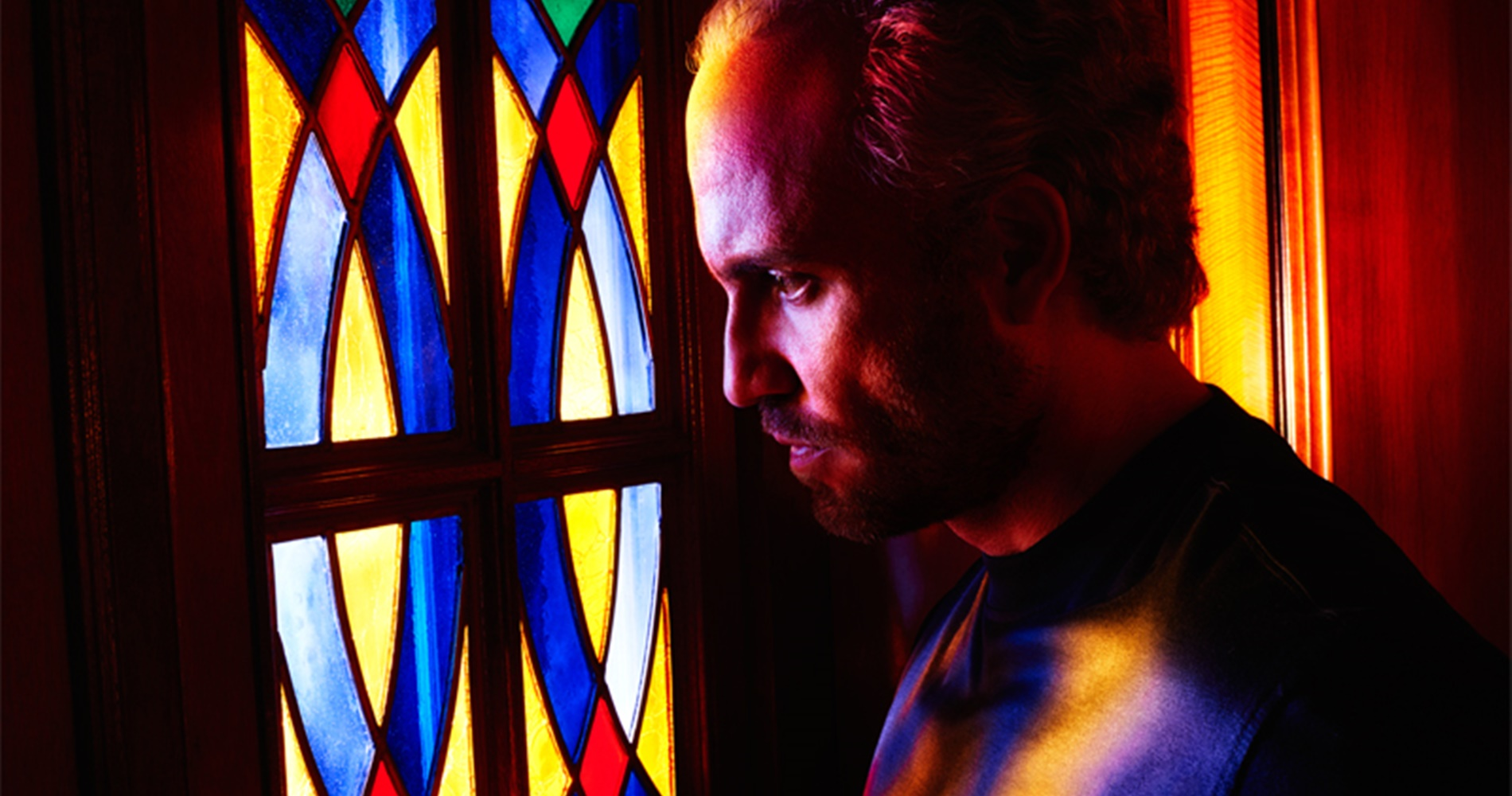 Giovanni Versace looking out a stained glass window., movies/tv, pop culture, wdc-slideshow