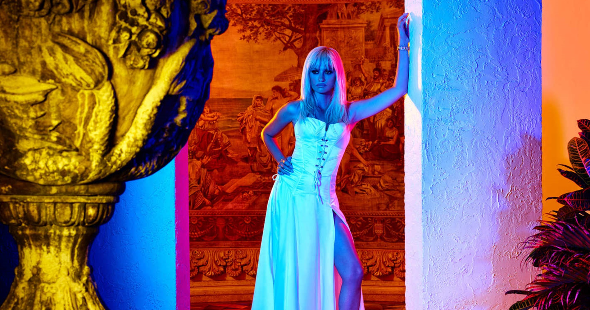 Donatella Versace wearing a white dress while she poses in a doorway., movies/tv, pop culture, wdc-slideshow
