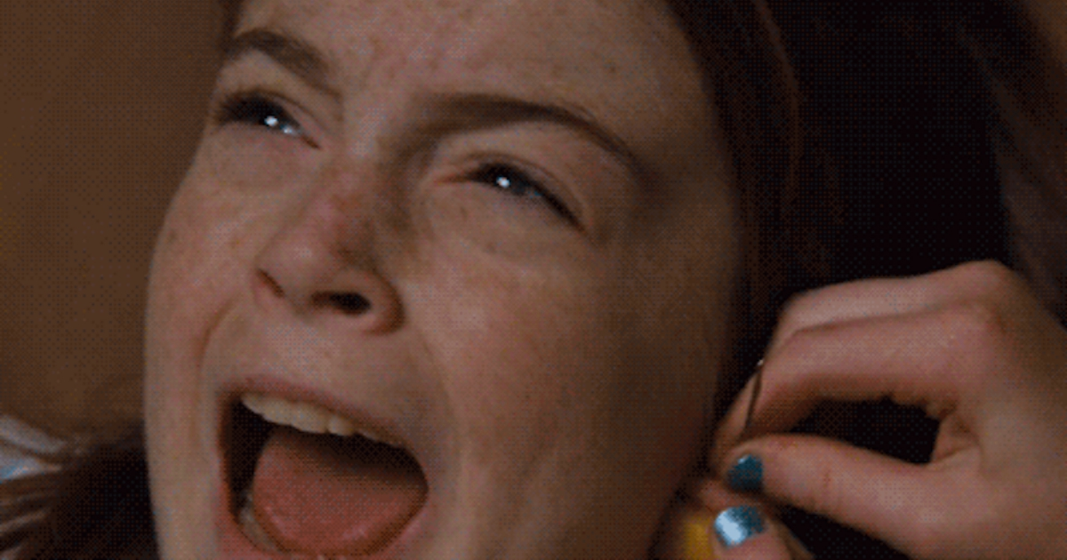 Annie getting her ears pierced with a needle by her twin sister Hallie in The Parent Trap, movies/tv