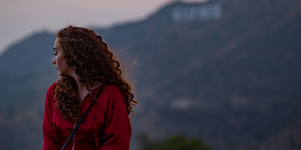 Red head girl in front of Hollywood sign, twilight, Earth Day Instagram Captions hashtags 2018, Earth day quotes, sayings, punny, funny, inspirational, earth day every day