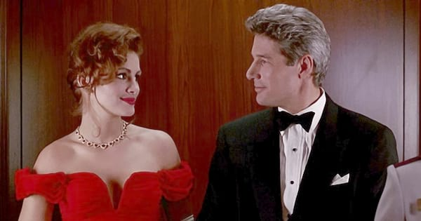 Julia Roberts in a red dress standing next to Richard Gere in an elevator in Pretty Woman, movies/tv