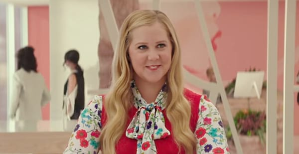 Amy Schumer in I Feel Pretty wearing a floral dress, celebs, movies/tv