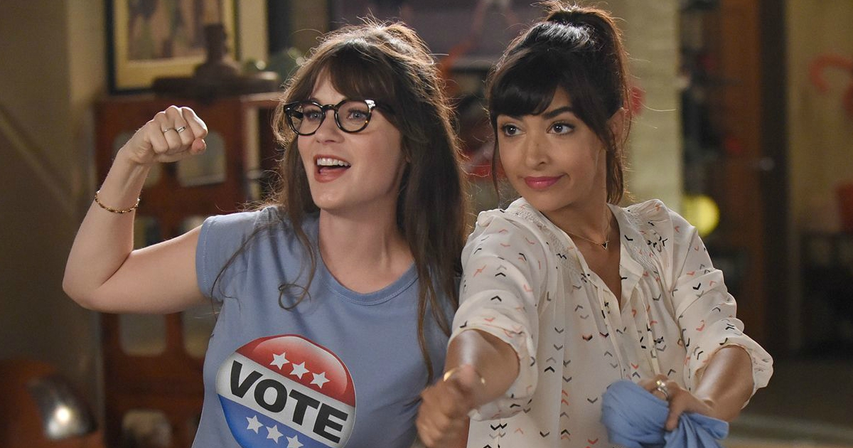 Jess and Cece posing while wearing \Vote\ T-shirts on an episode of New Girl, movies/tv