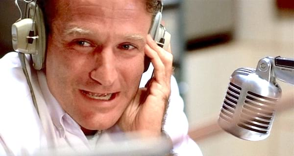 robin williams talks into a mocophone in the movie good morning, vietnam. robin williams, movies/tv, actor