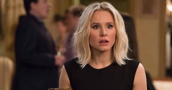 Kristen Bell as Eleanor in The Good Place looking shocked while holding a glass of wine