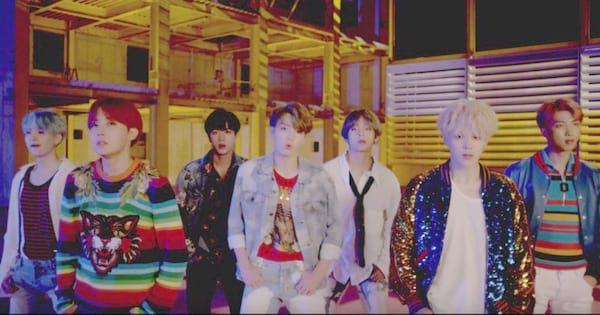 BTS performing in their music video for \DNA\