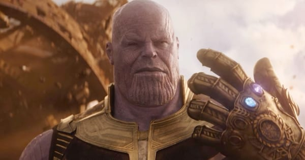 Thanos wearing the Infinity Gauntlet with the Infinity Stones in it in Avengers: Infinity War