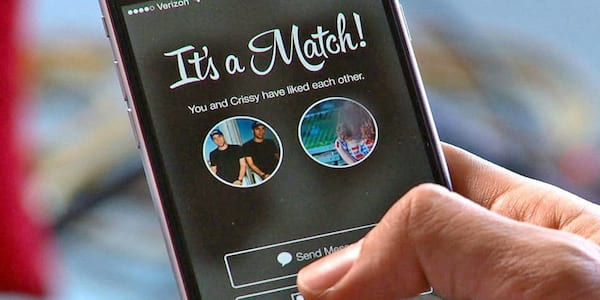 Tinder app on cell phone., relationships, science & tech, wdc-slideshow