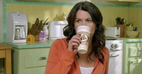 Lorelai Gilmore drinking coffee from a coffee cup on an episode of Gilmore Girls