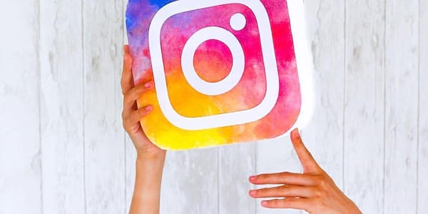 Person holding a copy of the Instagram logo., science & tech, wdc-slideshow