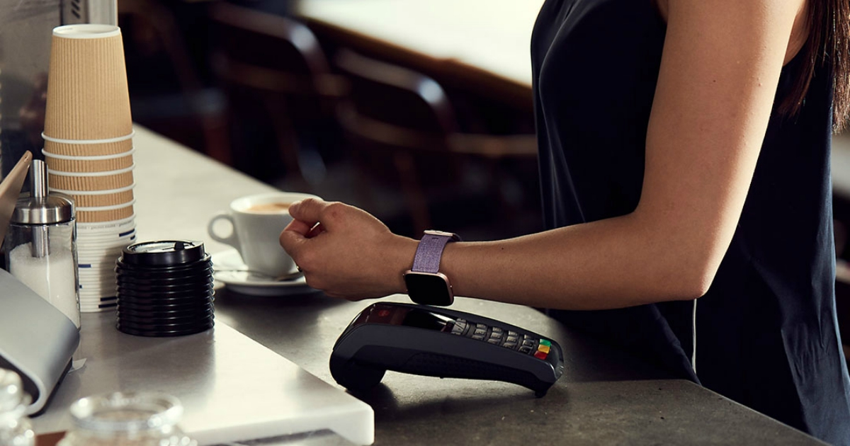 Woman paying for her coffee using her fitbit