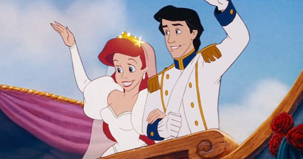Ariel and Prince Eric waving at people on a boat after getting married