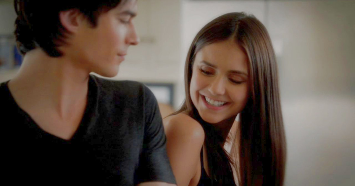 Elena smiling at Damon on an episode of The Vampire Diaries