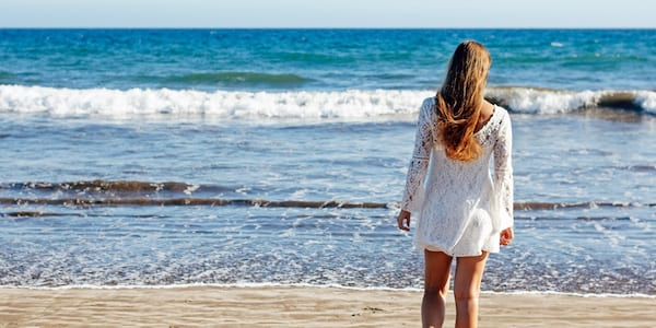 Woman standing on the beach., science & tech, wdc-slideshow
