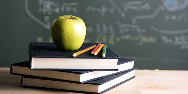 A stack of books with an apple on top., science & tech, school, wdc-slideshow