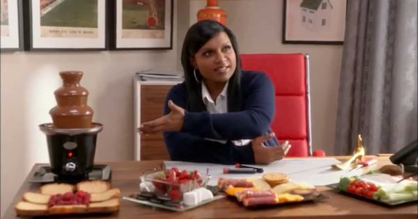 Minday Kaling in The Mindy Project next to a chocolate fondu kit