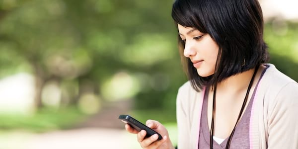 Woman looking down at phone., science & tech, career