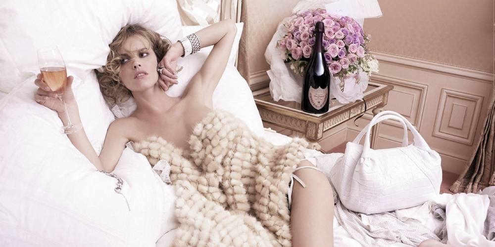 Woman lying in bed drinking rose., science & tech, food & drinks