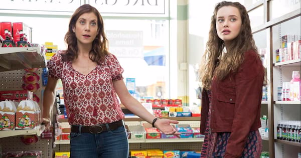 Hannah talking to her mom in the store during an episode of 13 Reasons Why
