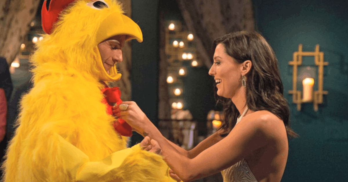 Becca K meeting a guy dressed up in a chicken costume on The Bachelorette season 14