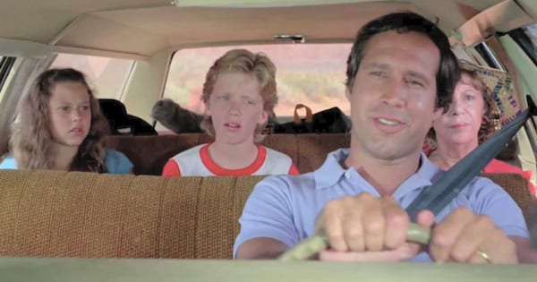 Clark Griswold driving in National Lampoon's Vacation