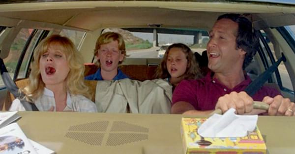 The Griswold family singing during their road trip in National Lampoon's Vacation