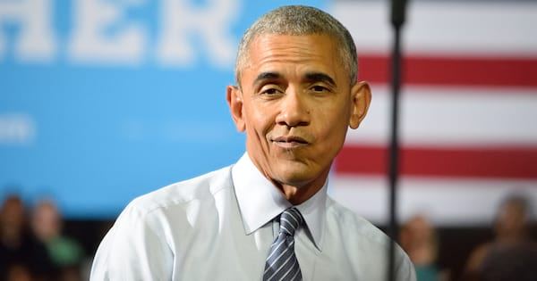 Barack Obama making a funny face at the camera while giving a speech