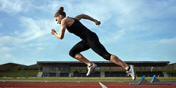 Womanrunning on a track., science & tech, fitness, health