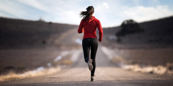 Woman running down road., science & tech, health, fitness