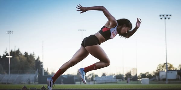 Woman running on a track., science & tech, fitness, health