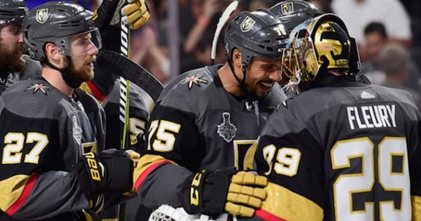 The Las Vegas Golden Knights celebrating after winning the first game in the Stanley Cup Finals