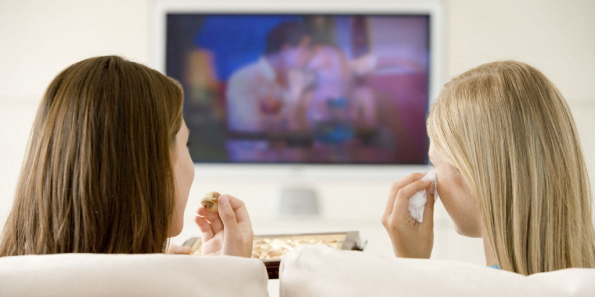 Two women watching TV., pop culture, tv, movies