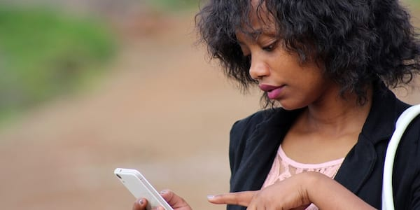Woman using cell phone., science & tech